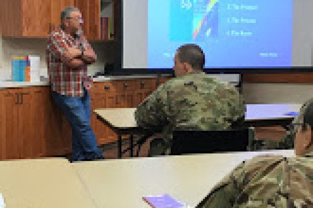 Dean Long discusses some of the tenants of his faith with interested BCT Soldiers, Aug. 13, 2017, at Cache Creek Chapel on Fort Sill, Okla. A retired Soldier, Long helped answer questions on how to be a Buddhist and a Soldier at the same time, as well as how to chant.