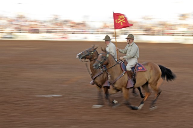 The Fort Sill Artillery Half Section warms up before its demonstration at the Lawton Rangers Rodeo, held at the LO Ranch, Aug. 9, 2017. The rodeo has been a local staple since 1939. The guidon is from B Battery, 3rd Battalion, 319th Field Artillery, which was Fires Center of Excellence and Fort Sill Commanding General Maj. Gen. Brian McKiernan's first command.