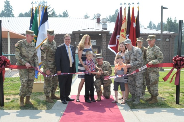 The Walls and Marchand families join I Corps, U.S. Medical Command and Madigan leadership along with Rep. Denny Heck at a ribbon-cutting event for the Joint Base Lewis-McChord Center for Autism Resources, Education and Services on Aug. 9.