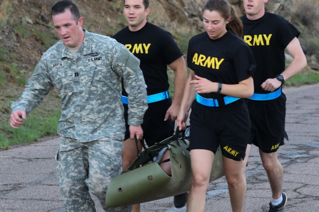 U.S. Army Intelligence Center of Excellence Students and Cadre execute a litter carry, prior to a Cognitive Enhancement Performance Program (CEPP) task during a Physical Readiness Training session at Fort Huachuca July 18.