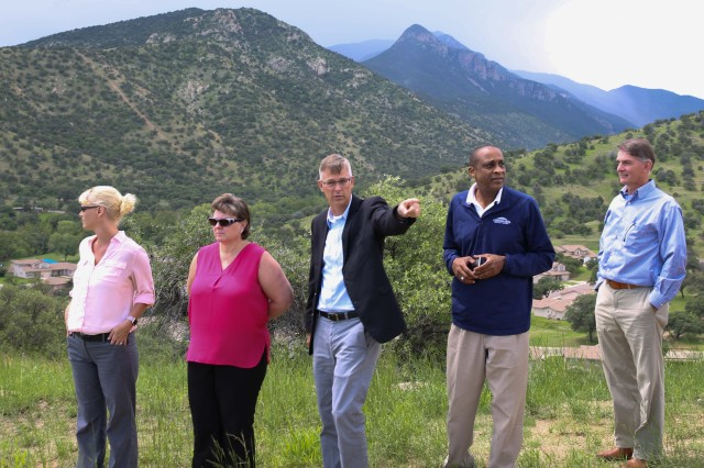 Members of the Canyon Vista Medical Center Executive Leadership Team take in the view from Star Hill as Jeffrey Jennings, Deputy to the Commanding General (Center), shows them the unique topography that makes up Fort Huachuca Aug. 4.