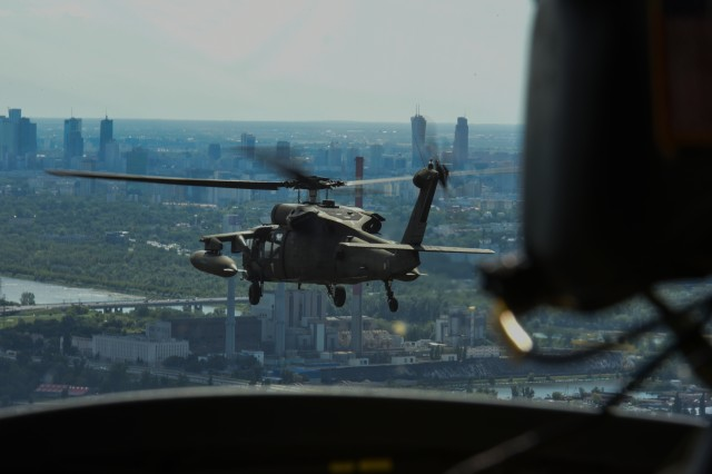 A UH-6 Black Hawk Helicopter from 1st Battalion, 214th Aviation Regiment, 12th Combat Aviation Brigade files over Warsaw, Poland, 15 Aug. 2017, the Polish Armed Forces Day parade.  A UH-60 Black Hawk, CH-47 Chinook and an AH-64 Apache helicopter from the 12th CAB participated in the Polish Armed Forces Day parade to show solidarity and partnership with our long standing NATO ally.