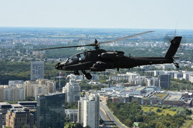 An AH-64 Apache Helicopter from 1st Battalion, 3rd Aviation Regiment, 12th Combat Aviation Brigade files over Warsaw, Poland during the Polish Armed Forces Day parade 15 Aug. 2017.  A UH-60 Black Hawk, CH-47 Chinook and an AH-64 Apache helicopter from the 12th CAB participated in the Polish Armed Forces Day parade to show solidarity and partnership with our long standing NATO ally.