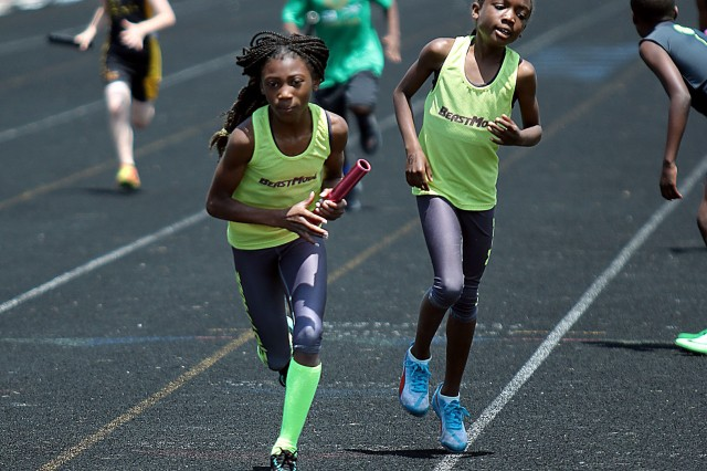 Fourth-grader Noelle Allen accepts the baton from her BeastMode teammate while running the 4x400-meter relay during the Jr. Olympics. Allen won the gold medal in the 100 and 200 meter races. She is currently the fastest 9 year old in the nation.