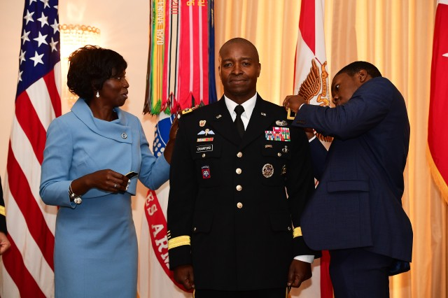 Lt. Gen. Bruce T. Crawford, the Army's newest chief information officer and G-6, was promoted from major general August 17, during a ceremony at Fort McNair.  His wife and son added the new rank to his epaulets.