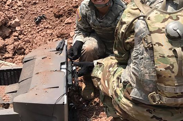 Sgt. Brittany Wildman sets a C4 explosive charge as part of her cavalry scout training at Fort Indiantown Gap, Pennsylvania. Wildman will go to the U.S. Army Airborne School before her next assignment with the U.S. Army 82nd Airborne Division at Fort Bragg, North Carolina.