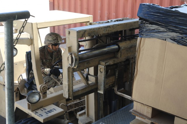 Spc. Gabriel Torres, an automated logistical specialist for Company A, 64th Brigade Support Battalion, 3rd Armored Brigade Combat Team, 4th Infantry Division, uses a forklift to move supplies for a resupply mission at Grafenwoehr Training Area, Germany, Aug. 15, 2017. The BSB is the key supplier for 3rd ABCT battalions providing a persistent presence across eastern Europe to deter aggression against NATO Allies and partners. (U.S. Army photo by Staff Sgt. Ange Desinor, 3rd Armored Brigade Combat Team, 4th Infantry Division)