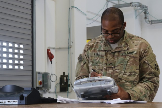 Pfc. James Hill, an automated logistical specialist for Company G, 1st Battalion, 68th Armor Regiment, 3rd Armored Brigade Combat Team, 4th Infantry Division, processes newly arrived parts at the supply support activity of the brigade's 64th Brigade Support Battalion at Grafenwoehr Training Area, Germany, Aug. 15, 2017. The BSB is the key supplier for 3rd ABCT battalions providing a persistent presence across eastern Europe to deter aggression against NATO Allies and partners. (U.S. Army photo by Staff Sgt. Ange Desinor, 3rd Armored Brigade Combat Team, 4th Infantry Division)