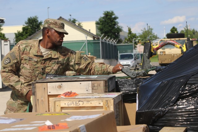 Spc. Charles Park, a motor transport operator for 64th Brigade Support Battalion, 3rd Armored Brigade Combat Team, 4th Infantry Division, secures supplies headed to Soldiers in Poland onto a palletized load system before a resupply mission at Grafenwoehr Training Area, Germany, Aug. 15, 2017. The BSB is the key supplier for 3rd ABCT battalions providing a persistent presence across eastern Europe to deter aggression against NATO Allies and partners. (U.S. Army photo by Staff Sgt. Ange Desinor, 3rd Armored Brigade Combat Team, 4th Infantry Division)