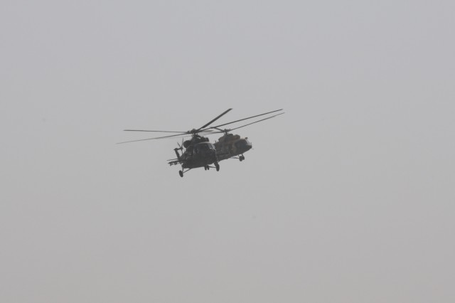 Iraqi army aviation Mi-17 helicopters transport Iraqi Security Forces during the aerial response force exercise at Camp Taji Military Complex, Iraq, August 13, 2017.The ISF provided security to an HH-60M Black Hawk Helicopter that was grounded due to simulated maintenance issues. This training is part of the overall Combined Joint Task Force - Operation Inherent Resolve building partner capacity mission which focuses on training and improving the capability of partnered forces fighting ISIS. CJTF-OIR is the global Coalition to defeat ISIS in Iraq and Syria. (US Army Photo by Staff Sgt. Isolda Reyes)