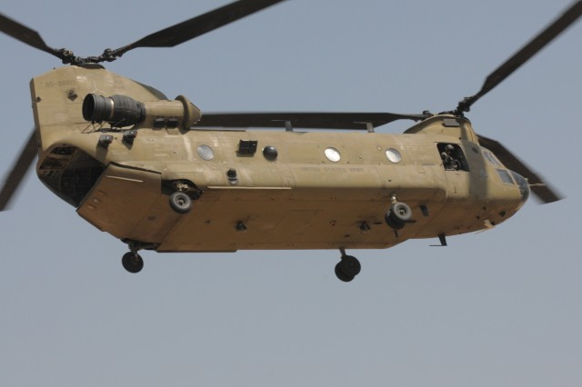 A CH-47 Chinook helicopter from 2-149th General Support Aviation Battalion, Task Force Rough Riders, transports Paratroopers from Task Force Red Falcon's Company C,1st Battalion, 325th Airborne Infantry Regiment, 2nd Brigade Combat Team, 82nd Airborne Division, during the aerial response force exercise at Camp Taji Military Complex, Iraq, August 13,2017. This training is part of the overall Combined Joint Task Force - Operation Inherent Resolve building partner capacity mission which focuses on training and improving the capability of partnered forces fighting ISIS. CJTF-OIR is the global Coalition to defeat ISIS in Iraq and Syria. (US Army Photo by Staff Sgt. Isolda Reyes)