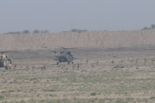 Iraqi Security Forces are inserted onto an objective by Iraqi army aviation Mi-17 helicopters prior to establishing a security perimeter during the aerial response force exercise at Camp Taji Military Complex, Iraq, August 13,2017. The ISF provided security to an HH-60M Black Hawk helicopter that was grounded due to simulated maintenance issues.This training is part of the overall Combined Joint Task Force - Operation Inherent Resolve building partner capacity mission which focuses on training and improving the capability of partnered forces fighting ISIS. CJTF-OIR is the global Coalition to defeat ISIS in Iraq and Syria. (US Army Photo by Staff Sgt. Isolda Reyes)