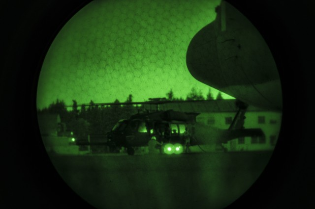 U.S. Marines with Marine Aerial Refueler Transport Squadron (VMGR) 152, refuel a U.S. Army MH-60 Black Hawk with the 4-160th Special Operations Aviation Regiment (SOAR), during night air delivered ground refueling for unit-level training Evergreen at Gray Army Airfield, Washington, Aug. 15, 2017. VMGR-152 used the opportunity during the joint training to give instruction on set up and operation of air delivered ground refueling with the 4-160th SOAR's airborne service detachment. Air delivered ground refueling offers a mobile deployable gas station to austere locations for units who don't have readily available resources near them. (U.S. Marine Corps photo by Cpl. Joseph Abrego)