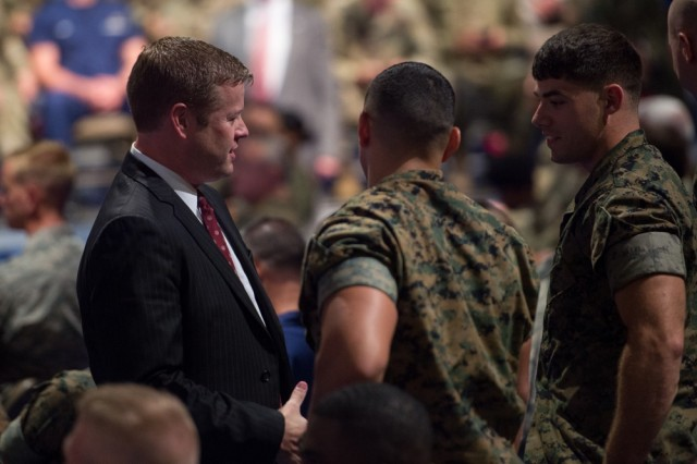 Acting Secretary of the Army Ryan McCarthy speaks with service members before President Donald J. Trump addressed the nation on the South Asia strategy at Conmy Hall on Fort Myer, Virginia, Aug. 21, 2017.