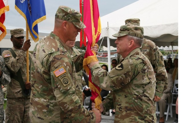 Col. Stephen Ledbetter accepts command of Letterkenny Army Depot and receives the Depot colors from Maj. Gen. Doug Gabram, AMCOM Commander, Friday.
