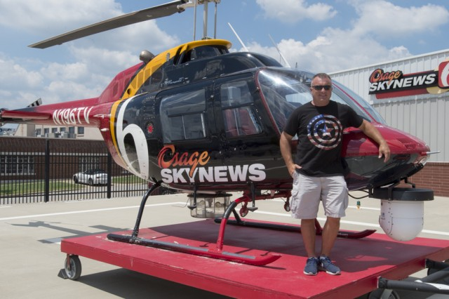 Meet Will Kavanagh, pilot for KOTV News on 6 in Tulsa, Oklahoma, and Oklahoma Army National Guardsman. Three Oklahoma Army National Guard helicopter pilots drill together in the same unit in Tulsa, Oklahoma, making them teammates in the Guard, but because of their civilian occupation, they are competitors in the sky. Chief Warrant Officer 3 Jon Welsh, pilot for KFOR News Channel 4 in Oklahoma city, Chief Warrant Officer 4 Chase Rutledge, pilot for KOCO News Channel 5 and Chief Warrant Officer 4 Will Kavanagh, pilot for KOTV News on 6 in Tulsa, Oklahoma, have served together in the OKARNG for nearly a decade, but when these three battle buddies take off their uniform, they compete against each other as civilians in the same media market.