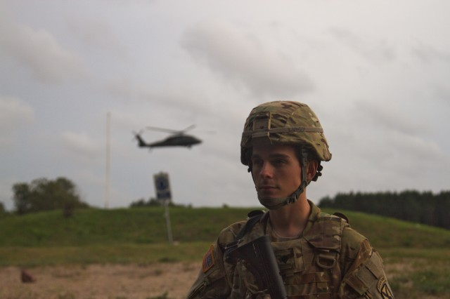 Army Spc. Alexander Lundy, an aircraft electrician with 3rd General Support Aviation Battalion, 10th Aviation Regiment, 10th Combat Aviation Brigade, 10th Mountain Division, pulls security during Exercise Falcon's Talon at Liepaja, Latvia on August 19, 2017.