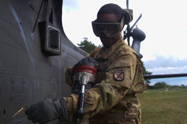 Army Sgt. Thomas Ross, a fueler with 3rd General Support Aviation Battalion, 10th Aviation Regiment, 10th Combat Aviation Brigade, 10th Mountain Division, finishes fueling a UH-60 Black Hawk during Exercise Falcon's Talon at Liepaja, Latvia on August 20, 2017.
