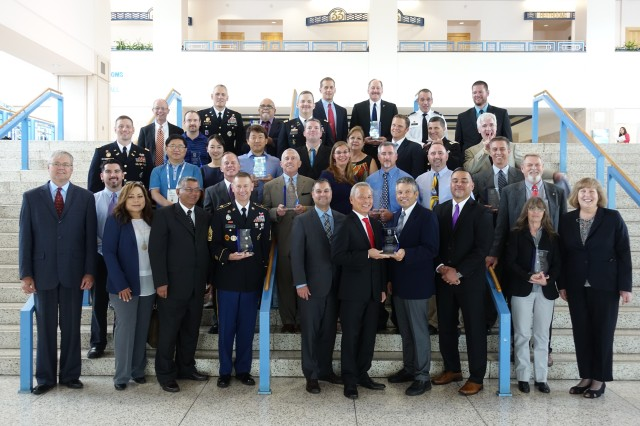 Many of the forty-nine recipients of 2017 Secretary of the Army Energy and Water Management Awards gather following the awards ceremony with Mr. Randy Robinson, acting assistant secretary of the Army for Installations, Energy and Environment (front row far left), and Ms. Carla Coulson, acting deputy assistant chief of staff for Installation Management (front row far right) during the Energy Exchange Symposium held in Tampa Florida. The Awards are presented in categories related to energy efficiency, energy management, and water conservation.