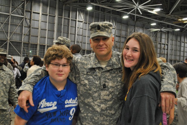 Evan, son; Snyder; and Kaylee, daughter, after returning home from deployment.