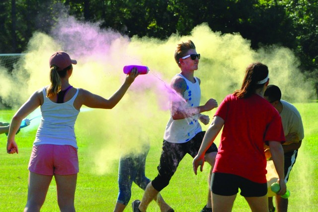 The new school year at Fort Jackson began Tuesday morning, but the post's Youth Sports department got things started a little early with a color run Saturday. Runners of all ages began to line up at 9 a.m. at the Youth Sports Complex, where they darted through clouds of colored chalk dust as they made their way around the course. Afterward, children enjoyed a variety of activities set up at the location, including an obstacle course, a bounce house and kick ball games.