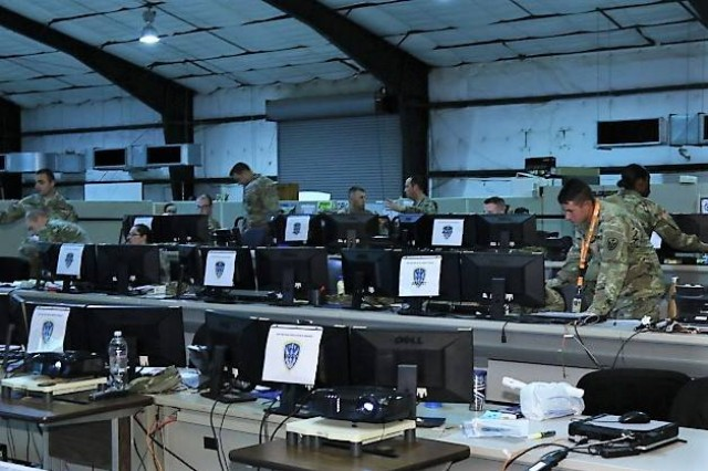 Soldiers with the 504th Military Intelligence Brigade man a Tactical Operations Center at Fort Hood's Mission Command Training Center during the brigade's EXEVAL, July 23-30.