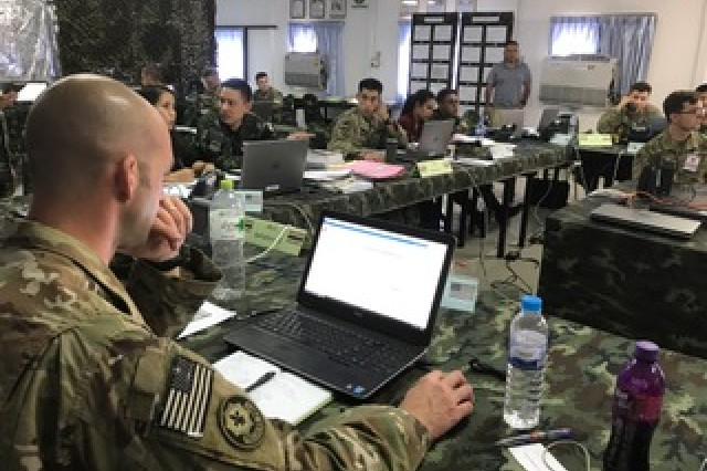 Capt. Benjamin Christian, of the 3rd Battalion, 21st Infantry Regiment, 1st Stryker Brigade Combat Team, 25th Infantry Division, reviews information for a commander's brief at Fort Surasri, Thailand Aug. 22, 2017.