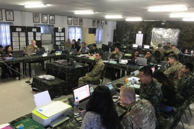 Soldiers of the 3rd Battalion, 21st Infantry Regiment, 1st Stryker Brigade Combat Team, 25th Infantry Division, paired with their Royal Thai Army counterparts, have a staff sync to ensure all information pertaining to the mission is disseminated before the commander's briefing during the battalion STAFFEX at Fort Surasri, Thailand Aug 22, 2017.