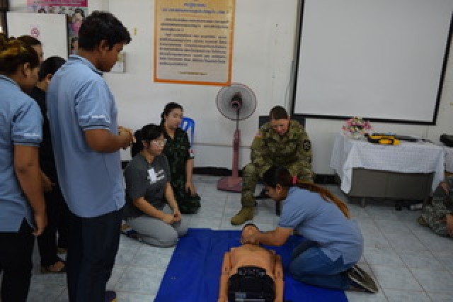 1st Lt. Cheri McCoy, of the Washington National Guard Medical Command, assists a Thai volunteer to find a pulse during a Basic Life Support class held in the Co-Operative Health Engagement: Che during Exercise Hanuman Guardian, Aug. 21, 2017.