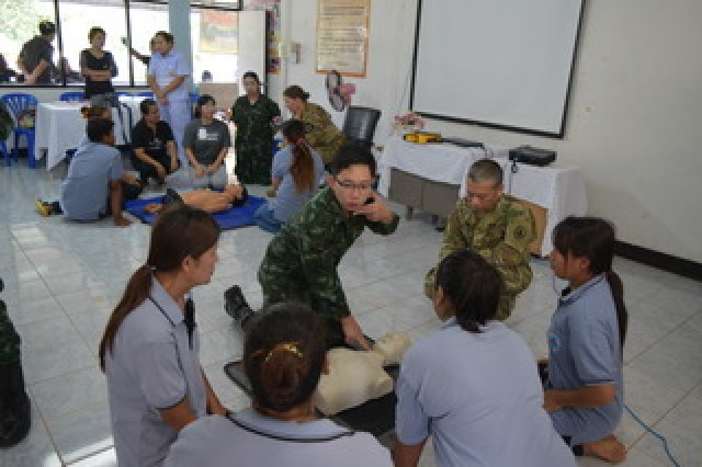 Dr. Korn Mattanyupiti, a resident Royal Thai Army Physician, demonstrates on both a mannequin and himself on how to do the center and up method to find a pulse during a Basic Life Support class held in the Co-Operative Health Engagement: Che during Exercise Hanuman Guardian, Aug. 21, 2017.