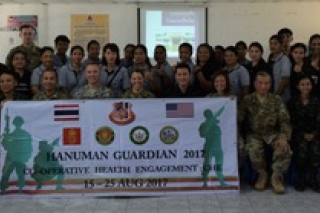 Members of the Washington National Guard Medical Command team, the Royal Thai Army, and volunteers from the Kanchanaburi community come together for a group photo during the Co-Operative Health Engagement: Che during Exercise Hanuman Guardian 17, Aug. 21, 2017.