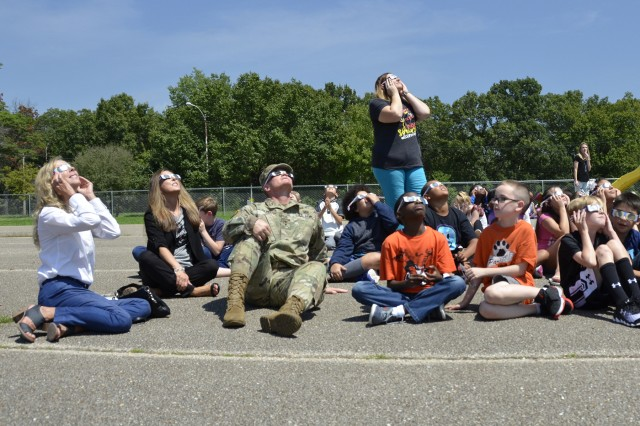 Maj. Gen. Kent Savre, Maneuver Support Center of Excellence and Fort Leonard Wood commanding general, and his wife, Mary Beth, far left, join fourth-grade students and staff at Partridge Elementary to view the eclipse Aug. 21.