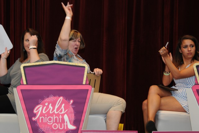 Friends Sara Carter and Teresa Hebda cheer as they win the Girls Night Out Frenemies game at Fort Rucker, Ala., Aug. 18.