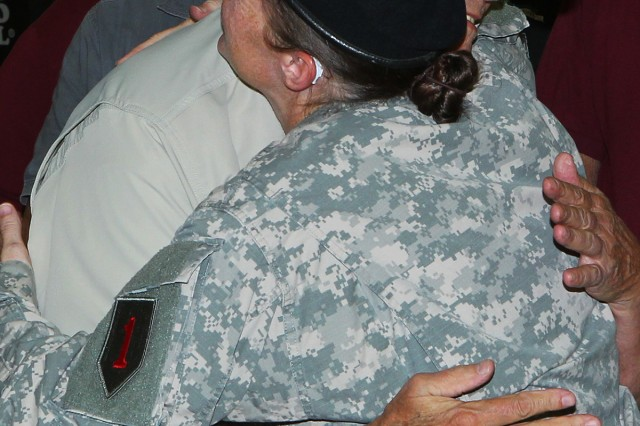 Sgt. Bevelyn Kozma, human resources technician, 1st Combat Aviation Brigade, 1st Infantry Division, gives a hug to Vietnam veteran before a welcome-home ceremony hosted by the 1st Inf. Div. on Aug. 23 at Marshall Army Airfield on Fort Riley, Kansas.�(Chad L. Simon, 1st Inf. Div. Public Affairs)