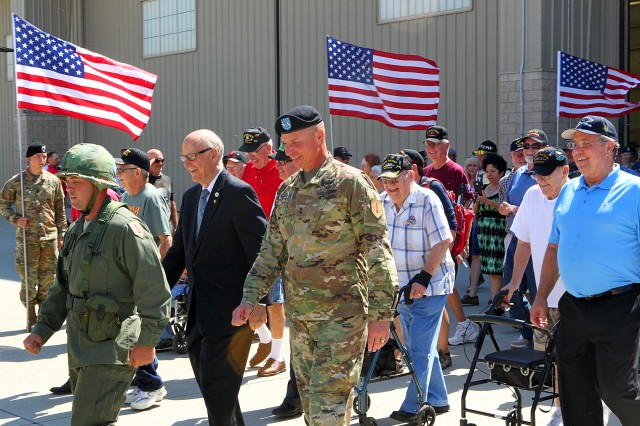 Veterans begin to march into the Vietnam Veterans Welcome Home Ceremony on Marshall Army Airfield Aug. 23. (Chad L. Simon, 1st Inf. Div. Public Affairs)