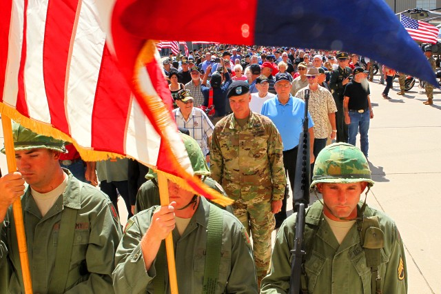 The Commanding General's Mounted Color Guard leads a parade of Vietnam-era veterans into a Welcome Home Ceremony Aug. 23 on Marshall Army Airfield (Chad L. Simon, 1st Inf. Div. Public Affairs)
