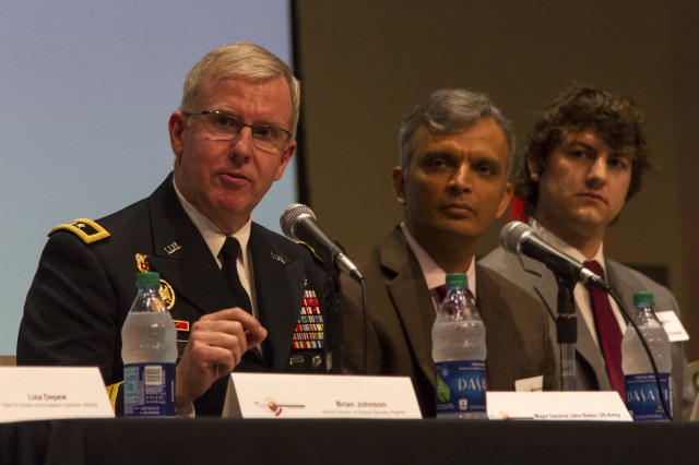 Maj. Gen. John Baker, commanding general, Network Enterprise Technology Command, discusses possible courses of action to attract a new generation of highly technical workforce, during a panel discussion at the Arizona State University Polytechnic campus August 23.