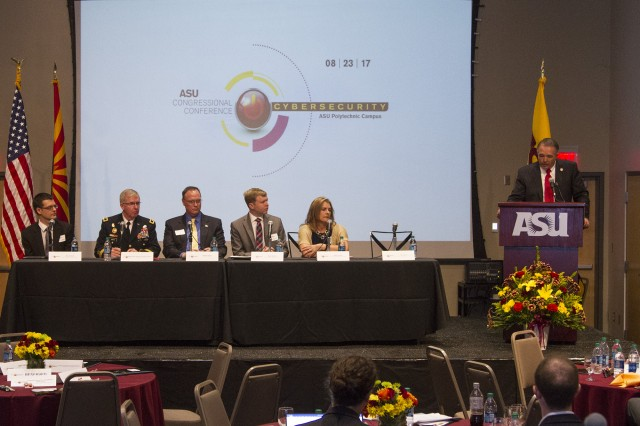 Arizona Rep. Trent Franks leads the panel discussion of Advance Capabilities in Threat Intelligence/Research at the Arizona State University Polytechnic campus August 23.