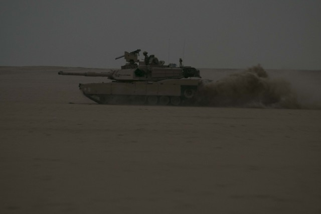An M1A2 Abrams Main Battle Tank assigned to Alpha Company, 1st Battalion, 12th Cavalry Regiment, 3rd Armored Brigade Combat Team, 1st Cavalry Division maneuvers through the Udairi Range Complex as a part of an attack on the opposing forces during the company's situational training exercise July 15, 2017. The STX was used to validate the unit through mission essential tasks to sustain the readiness of the combined arms battalions.