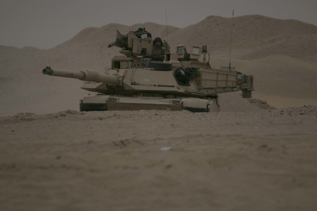 An M1A2 Abrams Main Battle Tank assigned to Alpha Company, 1st Battalion, 12th Cavalry Regiment, 3rd Armored Brigade Combat Team, 1st Cavalry Division maneuvers to the final objective during the company's situational training exercise July 15, 2017. The STX was used to validate the unit through mission essential tasks to sustain the readiness of the combined arms battalions.