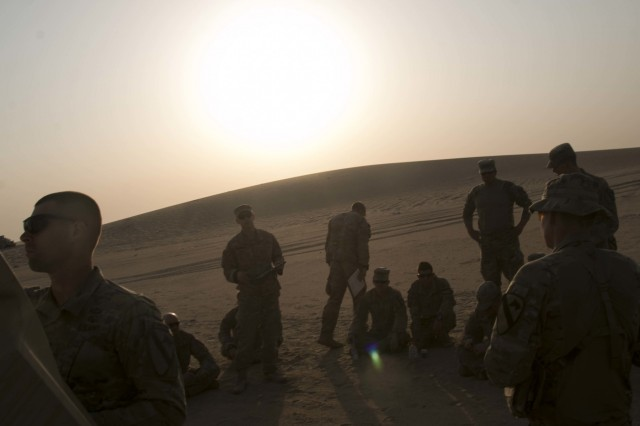 The Soldiers and leaders of Bravo Company, 2nd Battalion, 7th Cavalry Regiment, 3rd Armored Brigade Combat Team, 1st Cavalry Division gather for the after-action review following their three-day company situational training exercise at Udairi Range Complex in Kuwait Aug. 1, 2017. The brigade organized this training event to sustain the readiness of the combined arms battalions.