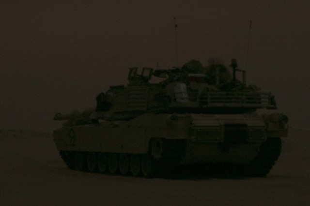 An M1A2 Main Battle Tank assigned to Bravo Company, 3rd Battalion, 8th Cavalry Regiment, 3rd Armored Brigade Combat Team, 1st Cavalry Division pulls area security in the tactical assembly area at Udairi Range Complex prior to conducting an early morning area defense against the opposing forces during the company's situational training exercise Aug. 12, 2017. The brigade organized this training event to sustain the readiness of the combined arms battalions.