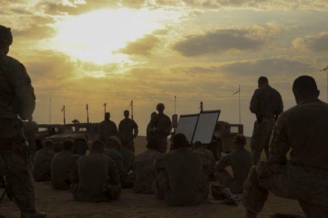 The Soldiers and leaders of Bravo Company, 3rd Battalion, 8th Cavalry Regiment, 3rd Armored Brigade Combat Team, 1st Cavalry Division gather around for the after-action review following their three-day company situational training exercise at Udairi Range Complex in Kuwait Aug. 12, 2017. The brigade organized this training event to sustain the readiness of the combined arms battalions.