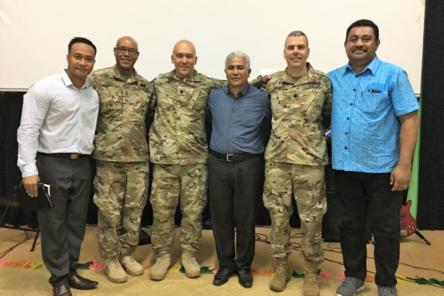 Left to right in uniform, Nevada Guard Soldiers Master Sgt. Stan Harvey, the Nevada Guard's top religious affairs sergeant, Lt. Col. Randy Lau, the State Partnership Program director, and Lt. Col. Hal Woomer Jr, the state command chaplain, take time out for a photo with Tongan religious leaders on July 23, 2017. The team visited local churches to improve its understanding of the importance of religion in Tongan culture.