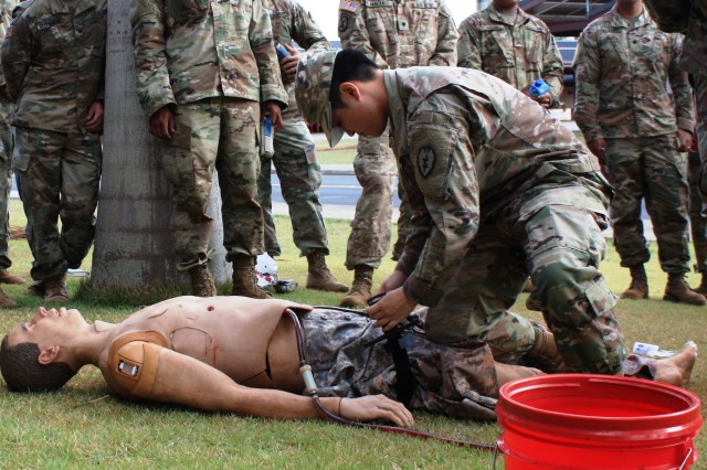 Spc. Szu Yeh applies a tourniquet to a mannequin during Squad Overmatch training at Schofield Barracks, Hawaii. Squad Overmatch integrates classroom teaching, virtual training and live exercises to improve combat medical skills and sharpen other abilities. (U.S Army photo by Mike Casey)
