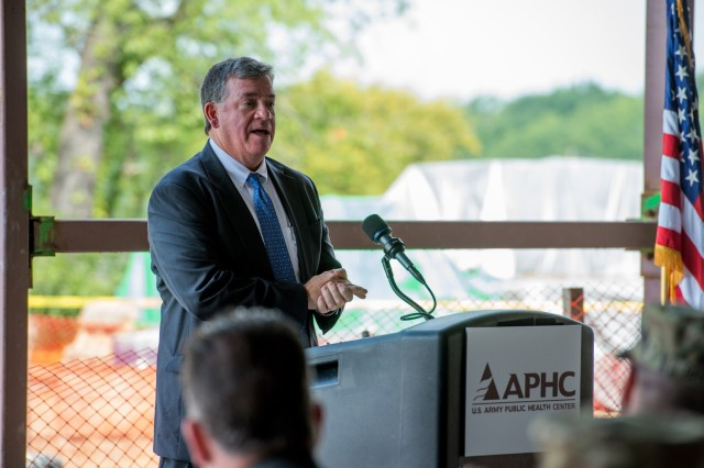 John Resta, director of the Army Public Health Center, addresses nearly 200 attendees at the Army Public Health Center's Topping Out ceremony for its new replacement laboratory facility at APG-South Aug. 16.