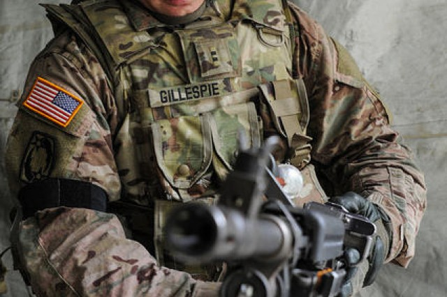 Chief Warrant Officer 2 Kristopher Gillespie with 10th Army Air & Missile Defense Command assembles the M240 machine gun during the European Best Warrior competition at Grafenwoehr, Germany, Aug. 22, 2017.Gillespie was named the 2017 U.S. Army Europe Warrant Officer of the Year.
