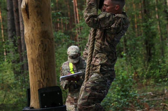Spc. Jacob Henriksen, 1st Battalion, 4th Infantry Regiment, JMRC, 7th Army Training Command, climbs a rope on an obstacle course during the 2017 European Best Warrior competition at Grafenwoehr, Germany Aug 21.Henriksen was named the 2017 U.S. Army Europe Junior Soldier of the Year.