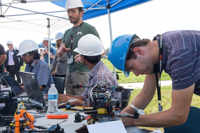 Research partners prepare an autonomous unmanned aerial vehicle for flight during demonstrations at the Army capstone event for a 10-year research program at Aberdeen Proving Ground, Maryland.