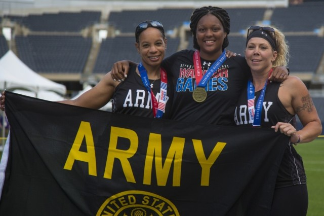 Army athletes Staff Sgt. Altermese Kendrick, Spc. Stephanie Morris and Sgt. Brandi Evans celebrate their medal wins at the 2017 DoD Warrior Games. Morris and Evans will be representing the US Team at the 2017 Invictus Games
